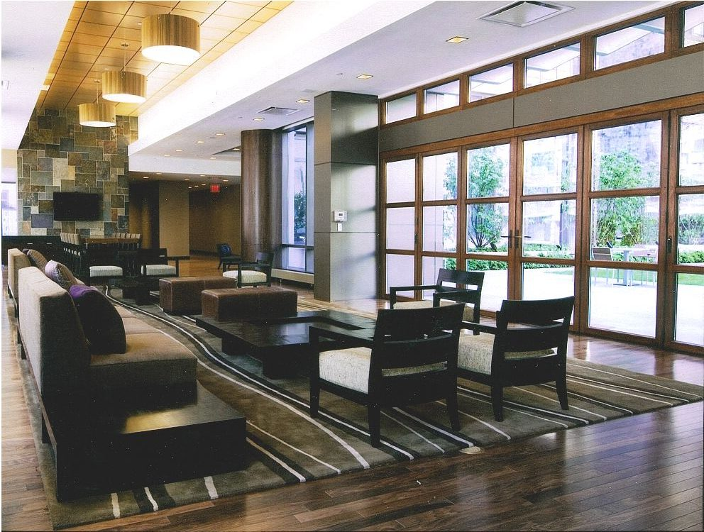 Walnut paneling with floating bench, Stainless Steel Reception Desk, Paneled Columns