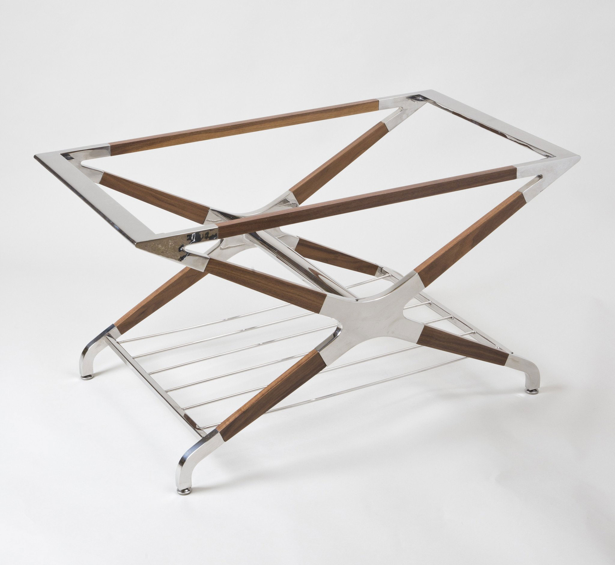 The X Table: Polished stainless steel and mahogany coffee table with glass top.