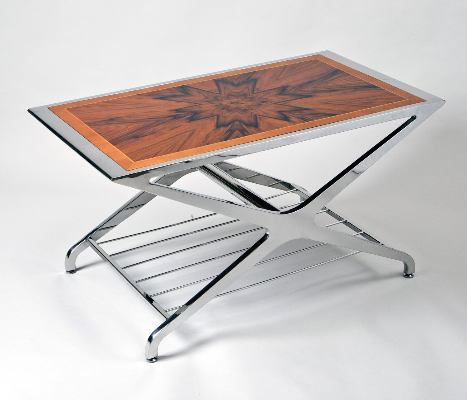 The X Table: Polished stainless steel coffee table with marquetry wood sunburst top.